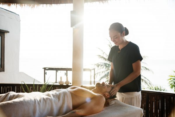 Massage Therapy. A massage therapist rubs a patients temples to alleviate stress and promote wellbeing. massage 5 Reasons to Get a Massage – That You Didn't Already Know About rawpixel 1072877 unsplash 1 600x403